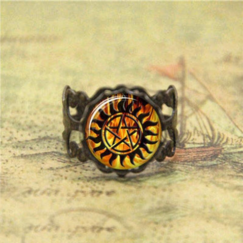Supernatural fire anti-possession pendant in bronze ring.