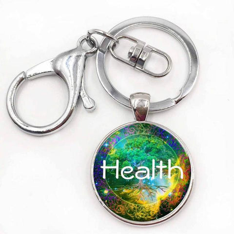 Glass dome Tree Of Life key chain in silver.