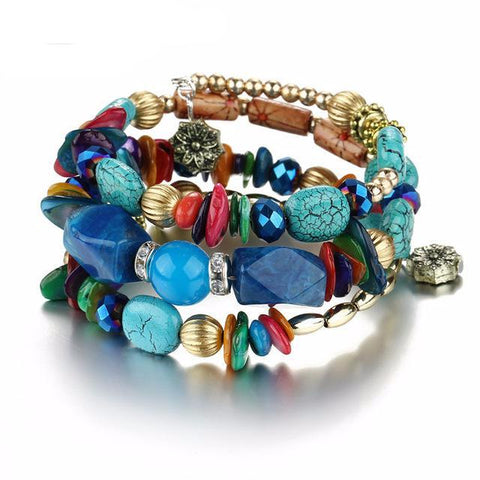 Picture of blue version of bangles, beads and stone bracelet.