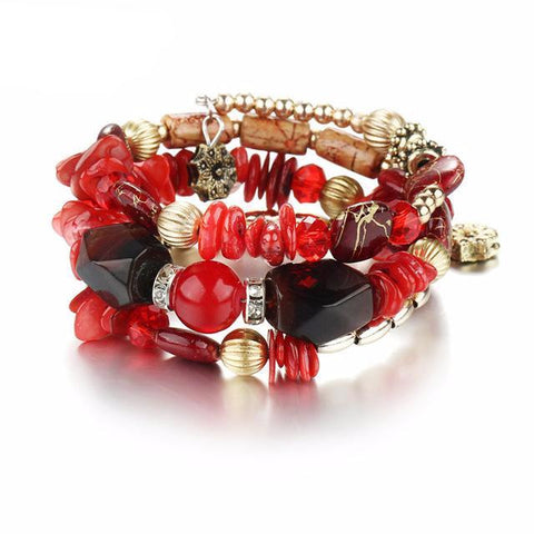 Picture of red version of bangles, beads and stone bracelet.