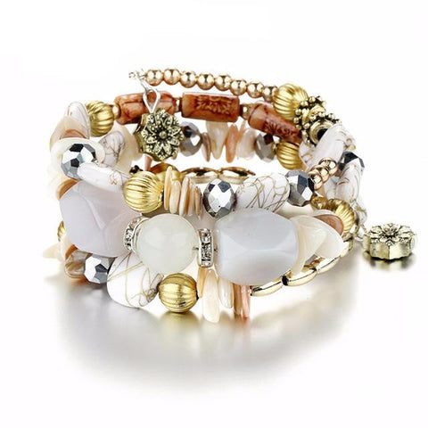 Picture of white version of bangles, beads and stone bracelet.