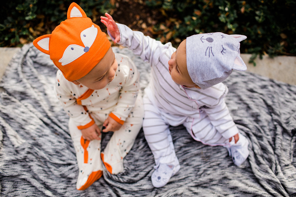 Boy-Girl Twins in matching cotton footies and hat
