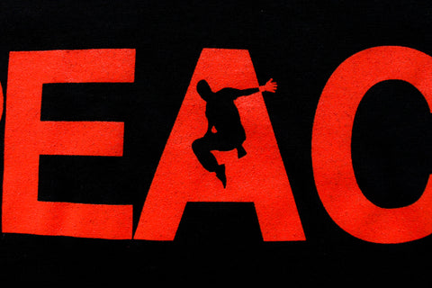 REACH/ESCAPE Black t-shirt with infra red print front close up. parkour, freerunning, streetwear