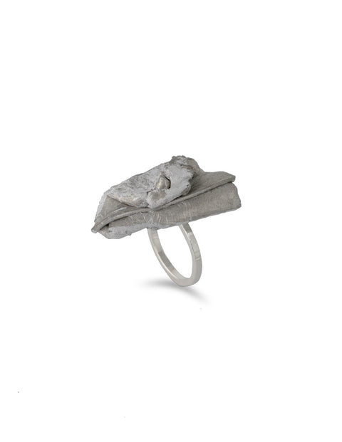 Avant-garde aluminum and sterling silver melt ring, handmade by Lissy Selvius
