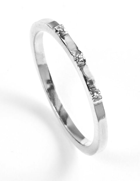Delicate sterling silver stack ring with white diamond gemstones handmade by Maura Lenahan.
