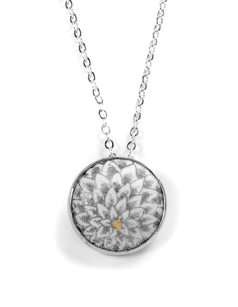 Small round enamel chrysanthemem pendant necklace with gold accents handmade by Nicolette Absil