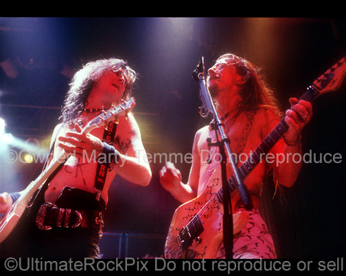 Photo of Duff McKagan of Guns N' Roses and Jerry Cantrell of Alice in Chains in concert by Marty Temme