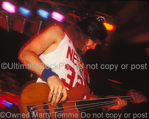 Photo of bass player Jeff Ament of Pearl Jam in concert in 1991 by Marty Temme