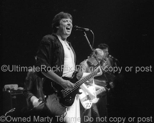 Photo of Chas Chandler of The Animals in concert in 1983 by Marty Temme
