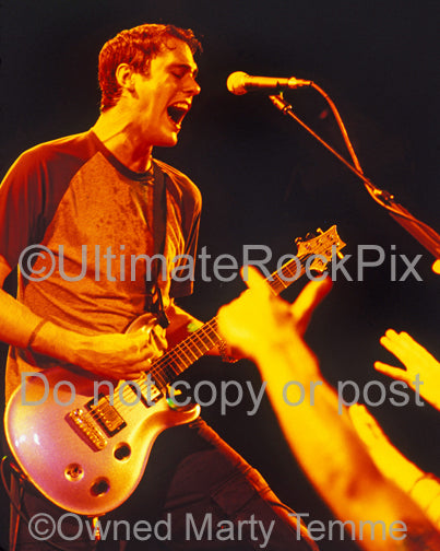Photo of Benjamin Burnley of Breaking Benjamin in concert in 2004 by Marty Temme