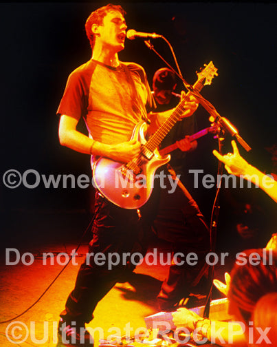 Photo of Benjamin Burnley of Breaking Benjamin onstage by Marty Temme
