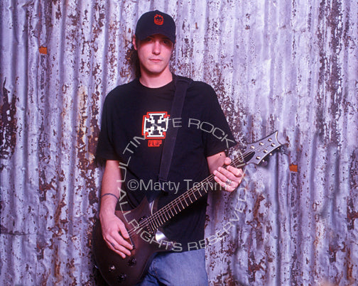 Photo of Benjamin Burnley of Breaking Benjamin with his guitar during a photo shoot by Marty Temme