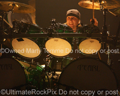 Photo of Michael Thomas of Bullet for My Valentine in concert in 2010 by Marty Temme