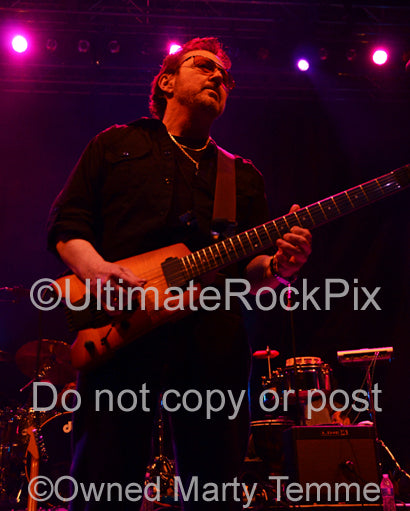 Photo of Buck Dharma of Blue Oyster Cult in concert in 2013 by Marty Temme