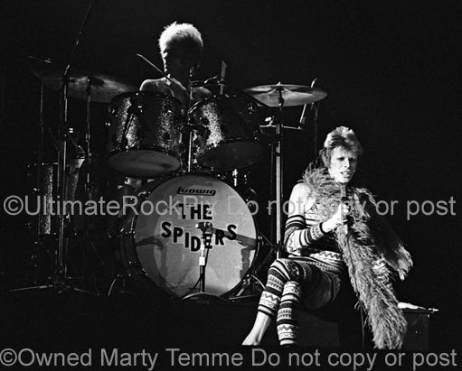 Black and white photo of David Bowie and Woody Woodmansey in concert in 1973 by Marty Temme