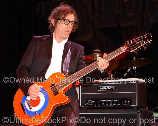 Photos of Tom Petersson of Cheap Trick in Concert in 2006 by Marty Temme