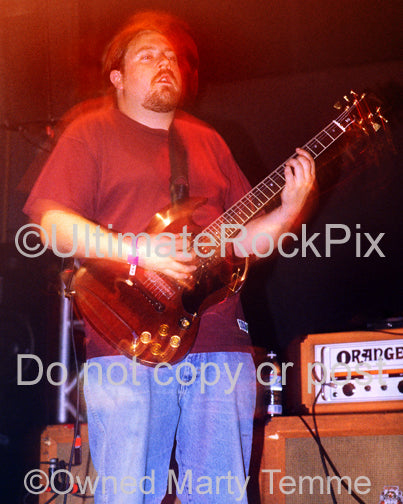 Photo of guitar player Tim Sult of Clutch in concert by Marty Temme