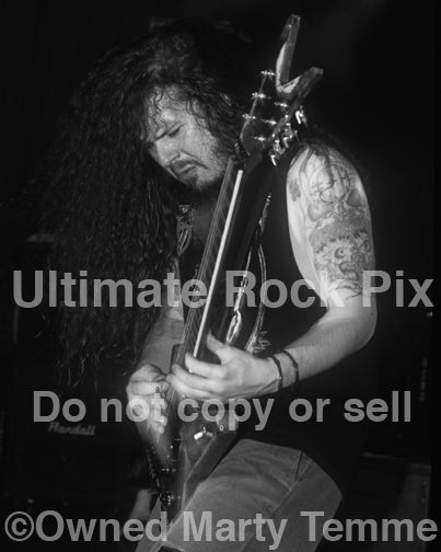 Black and white photo of Diamond Darrell Abbott of Pantera in concert in 1994 by Marty Temme