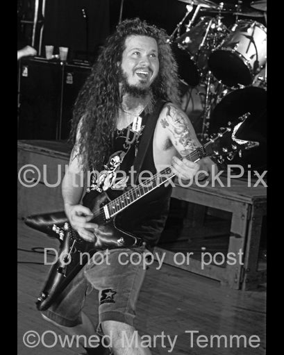 Black and white photo of Diamond Darrell of Pantera in concert in 1994 by Marty Temme