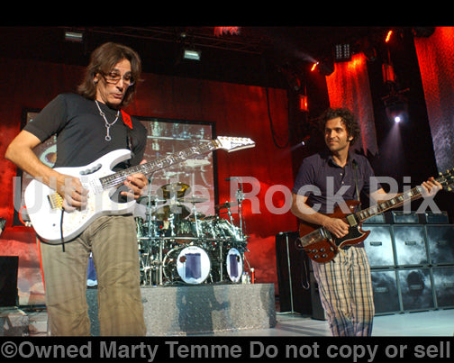 Photo of guitar players Dweezil Zappa and Steve Vai in concert in 2009 by Marty Temme