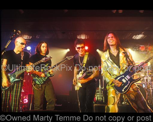 Photos of guitar players Joe Satriani, John Petrucci, Steve Vai and Paul Gilbert in concert in 1998 by Marty Temme