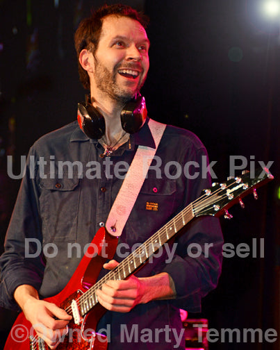 Photo of guitarist Paul Gilbert of Mr. Big in concert in 2012 in Los Angeles, California by Marty Temme