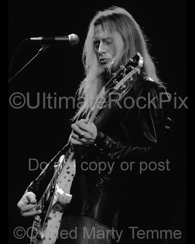 Black and white photo of Jerry Cantrell playing a white Les Paul in concert in 2002 by Marty Temme