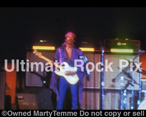 Photo of guitarist Jimi Hendrix performing in concert in 1969 by Marty Temme