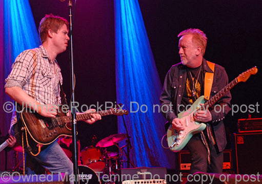 Photo of Jonny Lang and Brad Whitford in concert in 2010 by Marty Temme