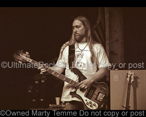Sepia tint photo of bassist Scott Reeder of Kyuss in concert in 1994 by Marty Temme