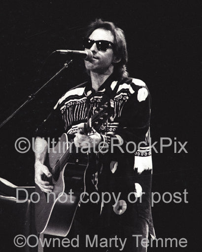 Photo of musician Nils Lofgren in concert in 1991 by Marty Temme