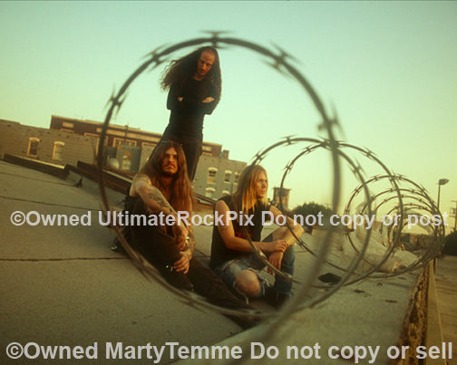 Photo of Scott Weinrich, Guy Pinhas and Greg Rogers of The Obsessed on a rooftop by Marty Temme