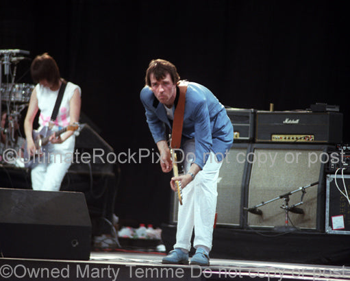 Photo of Robbie McIntosh of The Pretenders in concert in 1983 by Marty Temme