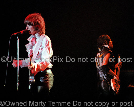 Photo of Chrissie Hynde and Pete Farndon of The Pretenders in concert in 1981 by Marty Temme