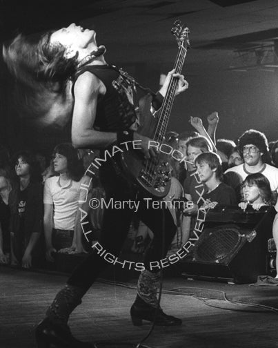 Photo of bassist Rudy Sarzo of Quiet Riot in concert in 1983 by Marty Temme