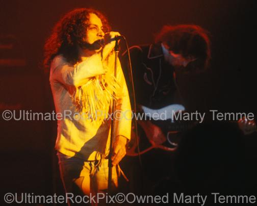 Photo of Ronnie James Dio and Ritchie Blackmore of Rainbow in concert in 1978 by Marty Temme