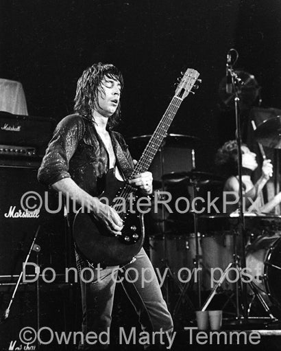 Photo of Pat Travers playing a Gibson Melody Maker in concert 1979 by Marty Temme