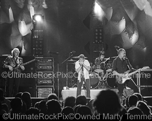 Photos of Pete Townshend, Roger Daltrey, John Entwistle and Zak Starkey of The Who in Concert in 2000 by Marty Temme