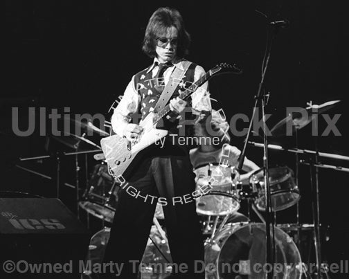 Photo of Jimmy McCulloch of Thunderclap Newman and Stone the Crows performing with John Entwistle of The Who in 1974 by Marty Temme