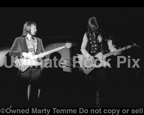 Photo of John Entwistle of The Who and Jimmy McCulloch of Stone the Crows in concert in 1974 by Marty Temme