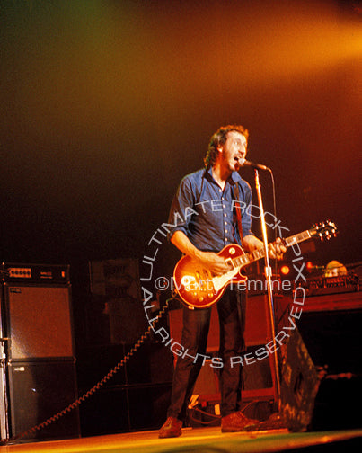 Photo of Pete Townshend of The Who playing a cherry sunburst Gibson Les Paul Deluxe in concert in 1980 by Marty Temme