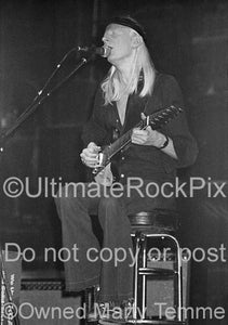 Black and white photo of Johnny Winter playing his Gibson Firebird in concert in 1979 by Marty Temme