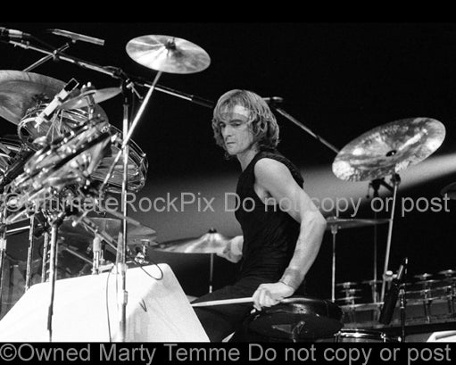 Photo of drummer Alan White of the band Yes in concert in 1978 by Marty Temme