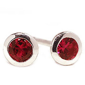 18 Karat White Gold Ruby Bezel Set Stud Earrings | OGI-LTD