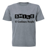 SMILE - it confuses people! - Kids T-Shirt