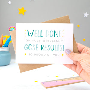 'Well done on such brilliant GCSE Results! So proud of you. A congratulations card featuring my hand drawn type in varying shades of blue, with a bright yellow stars around the grey text.