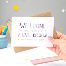 'Well done on such brilliant A-Level Results! So proud of you. A congratulations card featuring my hand drawn type in varying shades of pink, purple and blue, with a bright yellow stars around the grey text.