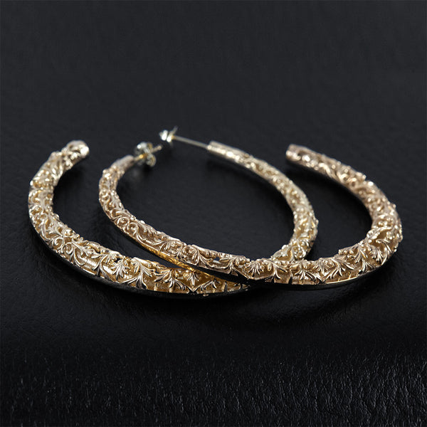 Big hoop earrings made in silver and gold plated.