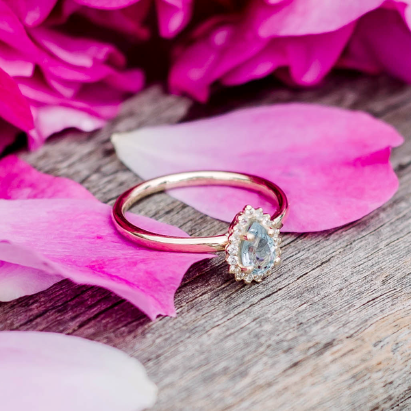 yellow gold ring on rose petals