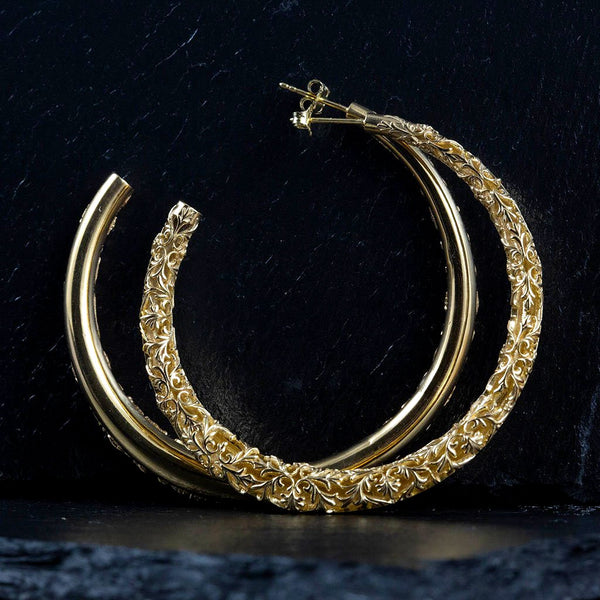 Big gold hoop earrings with a floral pattern